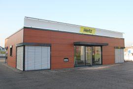 Hertz – Büropavillion mit Großcarport